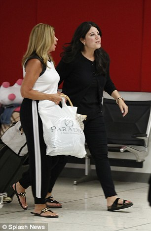 Dressed down: Monica Lewinksy looked relaxed as she strolled through Los Angeles airport with a friend