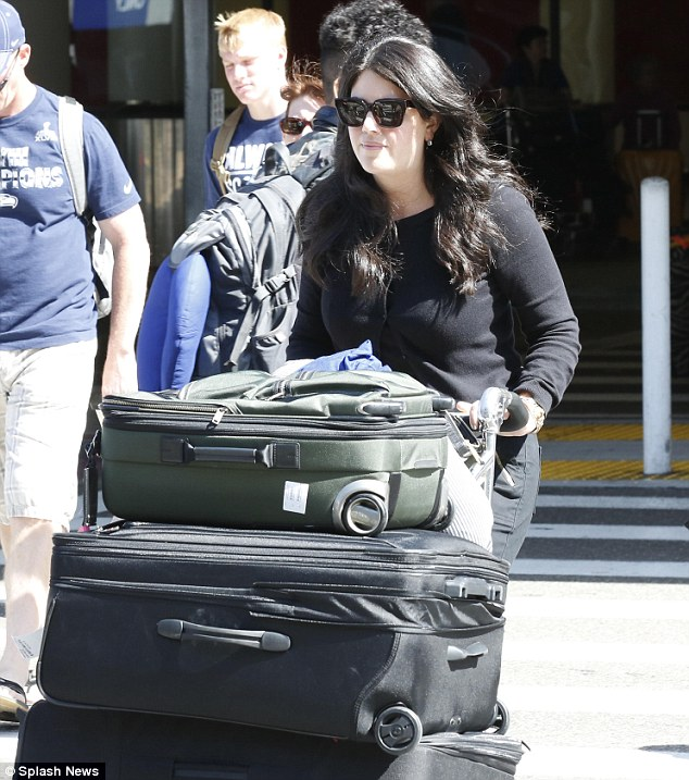 Tight-lipped: Monica Lewinsky dodged questions about Hillary Clinton's rumored presidential campaign when she reached LA airport