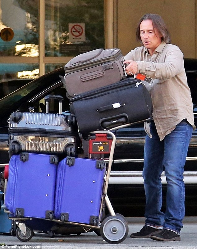 Travelling light? Robert had at least five big suitcases to load into the car