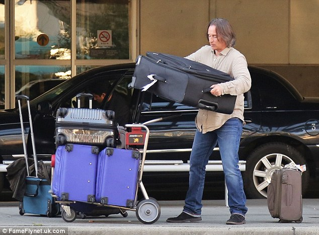 Once Upon A Struggle: Robert does some heavy lifting at the airport