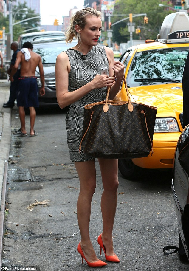 Laugh it off: Juggling her designer purse and phone, the actress stepped out of her car as she arrived likely for an appearance on The Tonight Show With Jimmy Fallon