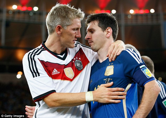 The world's greatest: Schweinsteiger commiserates Argentina's Lionel Messi after the final
