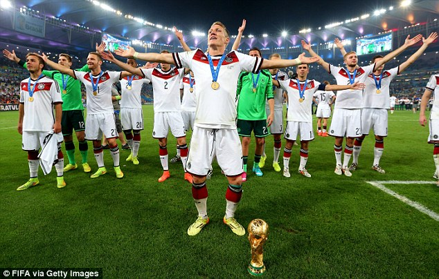 Moment to savour: The midfielder leads the celebrations with the Germany fans in the Maracana