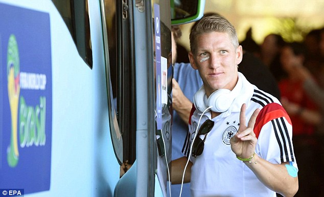 Mission accomplished: The Bayern Munich man boards the Germany team bus on Monday