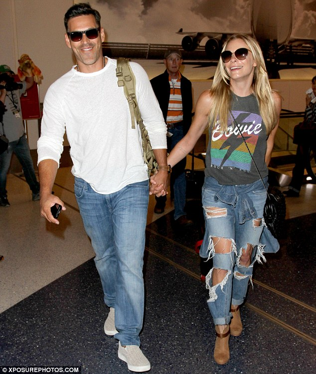 Big week! LeAnn Rimes and her husband Eddie Cibrian appeared to be a good mood as they arrived at Los Angeles International Airport on Monday - ahead of their reality TV series debut on Thursday