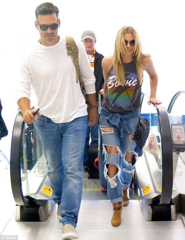 Sunny in there? The pair kept their sunglasses on as they strolled through the airport, making their way to NYC