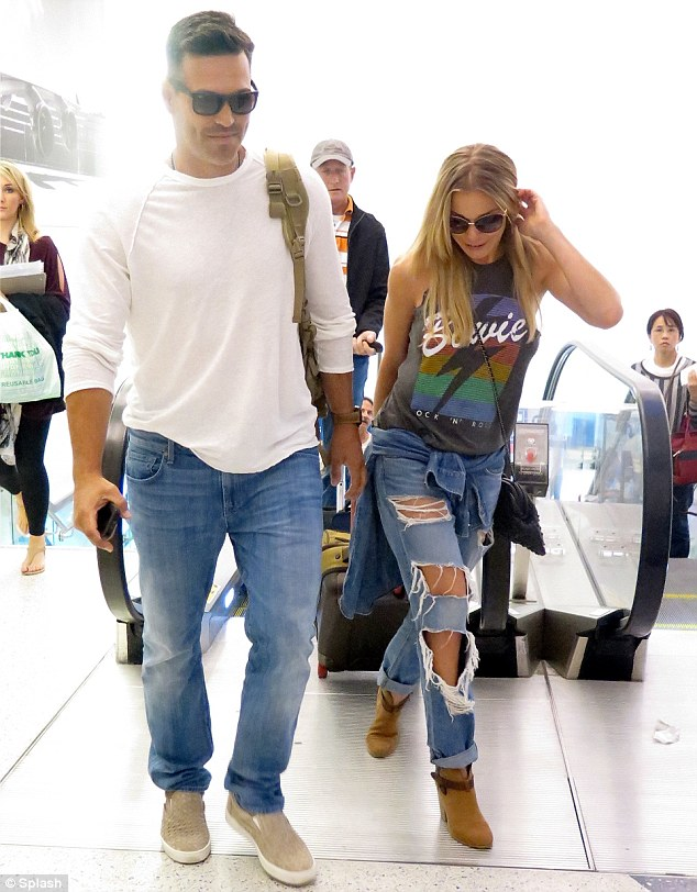 Casual: Meanwhile, Eddie wore a white blouse, jeans and grey slip-on shoes