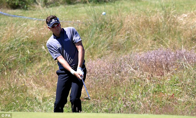 Playing through the pain: Ian Poulter will be taking painkillers to get him through The Open