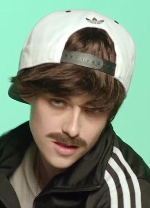 What a drag: Kristen Stewart dressed up as a man for Jenny Lewis's recently released video for the song Just One Of The Guys