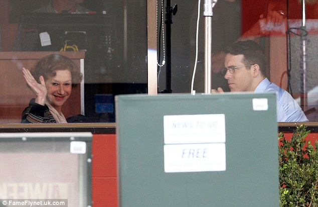 Good-natured: Helen gave a wave for the cameras as she and Ryan sat in a restaurant
