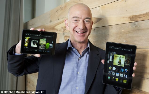 Big projects: Amazon founder Jeff Bezos shows off Kindle Fire tablet computers