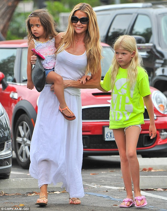 Peekaboo: Denise Richards showed off her black bra and her legs under her slightly see-through vest and skirt as she took daughters Eloise, three, and Lola, nine, shopping for groceries in Los Angeles on Monday