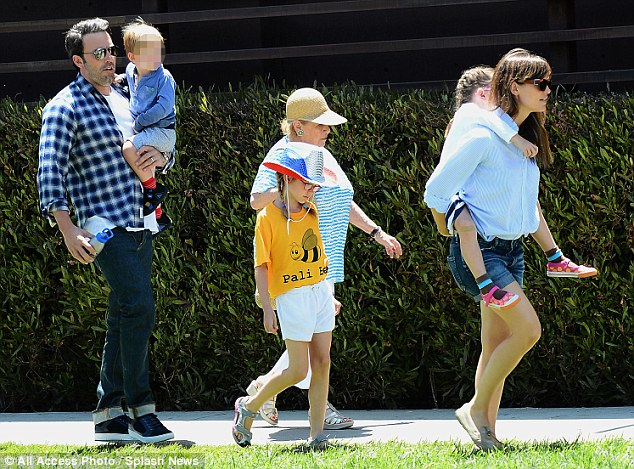 Family time: Ben Affleck carried his son Samuel as his wife led the way in early July 2014 in Pacific Palisades