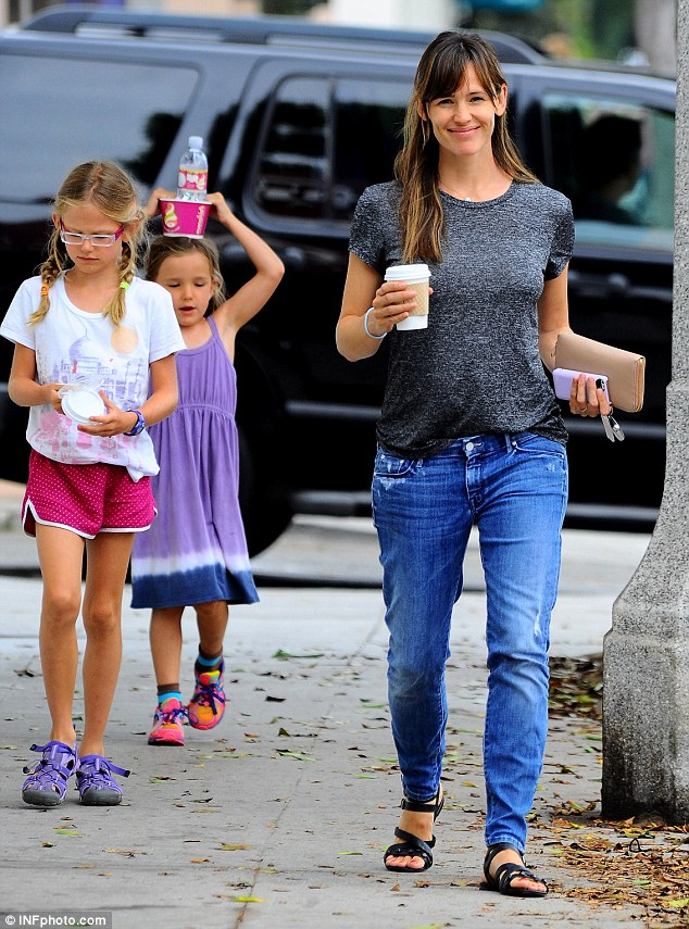 Her girls: Jennifer's daughters looked absolutely delighted following their trip to indulge in their sweet tooth