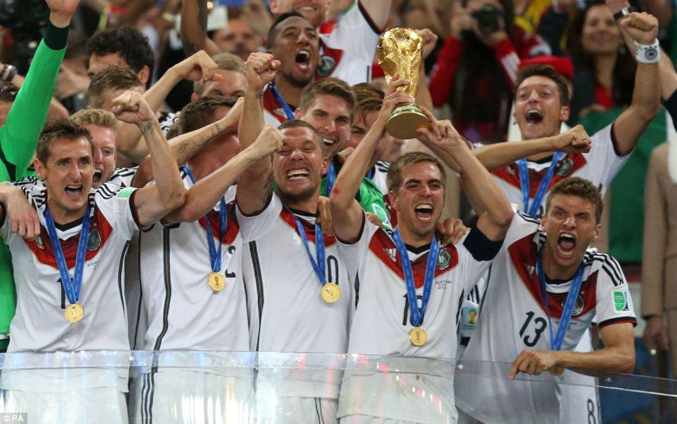 Germany's Philipp Lahm lifts the World Cup and celebrates victory with team-mates after the FIFA World Cup Final at the Estadio do Maracana, Rio de Janerio, in Brazil