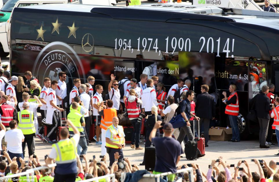 From the airport, the team set off for downtown Berlin in a bus painted with the years of Germany's World Cup victories: The previous occasions were in 1954, 1974 and 1990