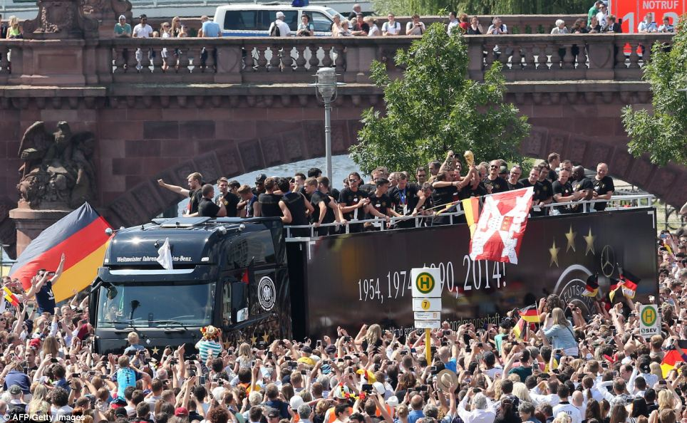 An estimated 400,000 people packed the 'fan mile' in front of Berlin's landmark Brandenburg Gate to welcome home coach Joachim Löw's team and the trophy