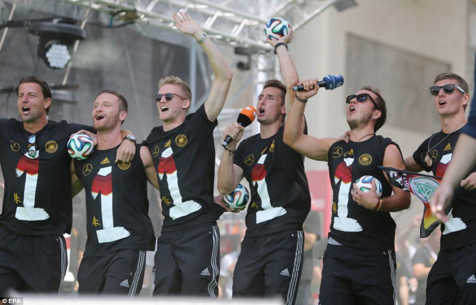 Mario Götze and Miroslav Klose lead the celebrations with teammates at the event in Berlin