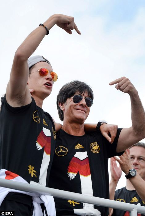 Manager Joachim Löw (pictured with Julian Draxler) told the crowd 'We're all world champions!' at the victory celebrations