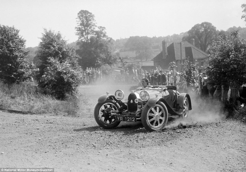 A Bugatti type 37 thunders round a corner in a cloud of dust during the Bugatti Owners Club hill climb in 1935