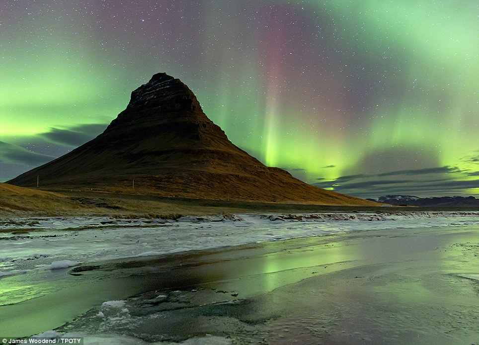 Lighting up the sky: British photographer James Woodend captured this stunning image of the Northern Lights in Kirkjufell, West Iceland