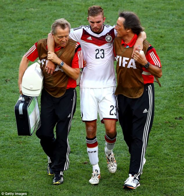 Germany's Christoph Kramer is helped off the pitch by medical staff after sustaining an injury in the World Cup final against Argentina. Kramer has now said he has no recollection of the first half of the match