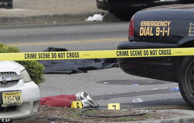 The suspect: The gunman was wearing burgundy sweatpants, according to a witness, his body was still on the ground hours after he killed Officer Santiago