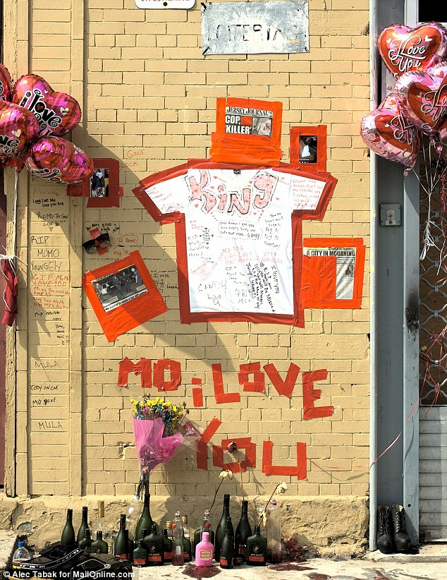 Two deaths: The memorial has now been merged with another to Lavon King (aka Mo Mo), a local who was also killed by a police officer this summer. Newspaper clippings on the new memorial refer to Campbell's death