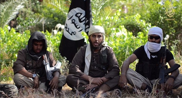 Propaganda: Former Aberdeen schoolboy Abdul Raqib Amin (right) was filmed alongside fellow British extremists Reyaad Khan (left) and Nasser Muthana (centre), both 20, urging other Muslims to fight for ISIS