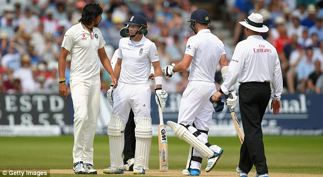 Peacemaker: Jimmy Anderson (right) steps in to diffuse a row between Joe Root (centre) and Ishant Sharma