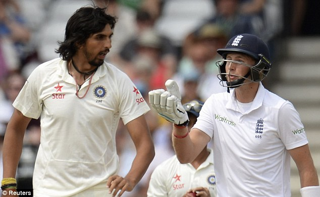 Making his point: Joe Root (right) and Ishant Sharma continue to argue during the first Test