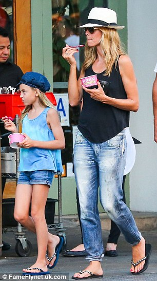 Popular pick: Seen as a 'healthier', lower-fat alternative to ice cream, frozen yogurt is a favorite treat among stars including Rosie Huntington-Whiteley (left) and Heidi Klum (right)
