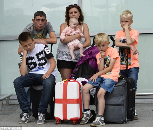 BPM MEDIA Stephen Pritchard and his son Jake Kelly age 14 and Jo Housley and her baby daughter Erin and sons Charlie and Jordan who are stranded at Birmingham Airport after  staff at East Midlands Airport Put them on a flight to Latvia instead of their holiday destination Almeria in Spain by mistake.