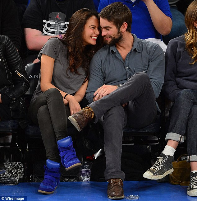 Over: Chace Crawford has revealed his romance with model Rachelle Goulding is no more - the pair are pictured here at a Knicks game at Madison Square Garden in New York in March last year