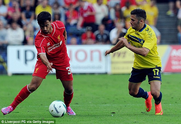Making space: Liverpool forward  Suso tries to get away from Riza Durmisi of Brondby