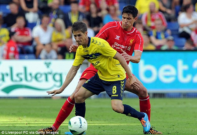 Tussle:  Martin Kelly of Liverpool competes with Martin Ornskov of during the pre-season friemdly