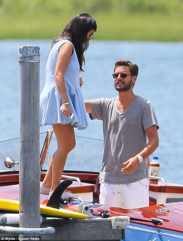 What a gent! The 31-year-old reality star helped his 35-year-old partner into a boat in the Hamptons in New York on Saturday