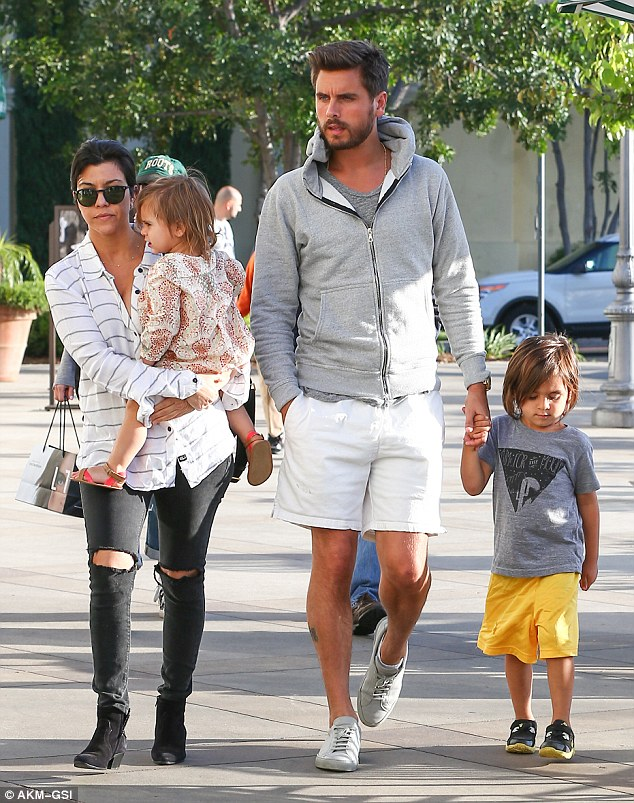 One big happy family! Kourtney and Scott pictured with their children, four-year-old Mason and two-year-old Penelope, who will soon be joined by a third sibling