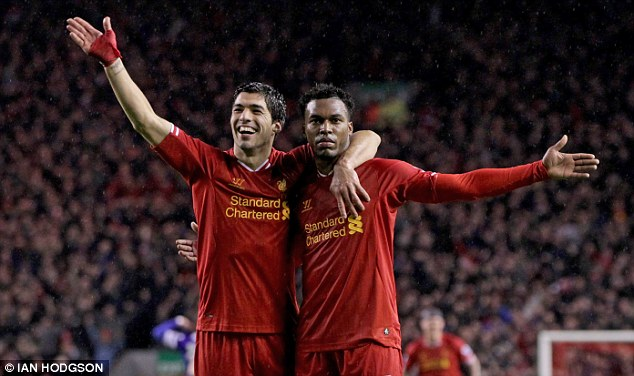 Taking it on: The 24-year-old is now Liverpool's key man up front after the departure of Luis Suarez (left)