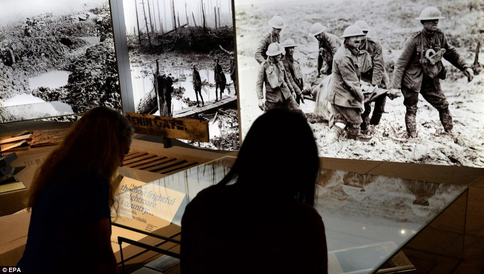 Visitors look at exhibits displayed in the First World War Gallery which convey what life was like on the frontline during the Battle of the Somme. Objects on display range from weapons, uniforms and equipment to diaries, letters, keepsakes and trinkets, photographs, film and art