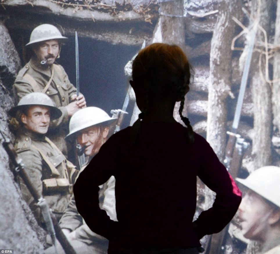 A young girl is silhouetted against a First World War image of the inside of a make-shift trench on the frontline at the 'World War Galleries' exhibit. The new exhibit coincides with the 100th anniversary of the outbreak of the conflict