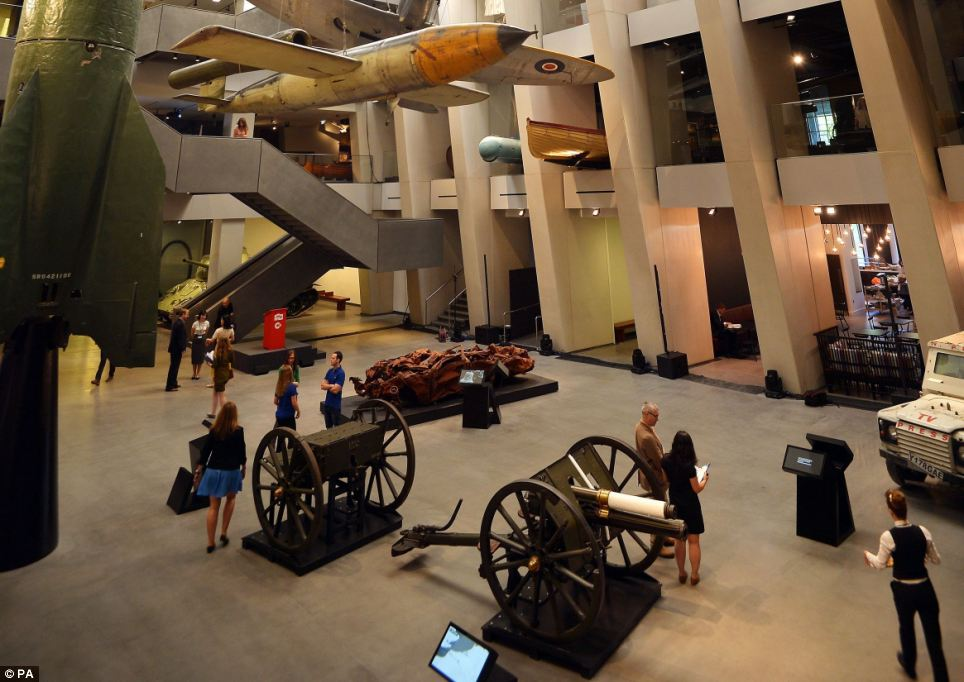 The new atrium was designed by Lord Foster's firm, Foster and Partners, and also features a T-34 tank, field guns and a Reuters news agency Land Rover destroyed by rocket fire in Gaza