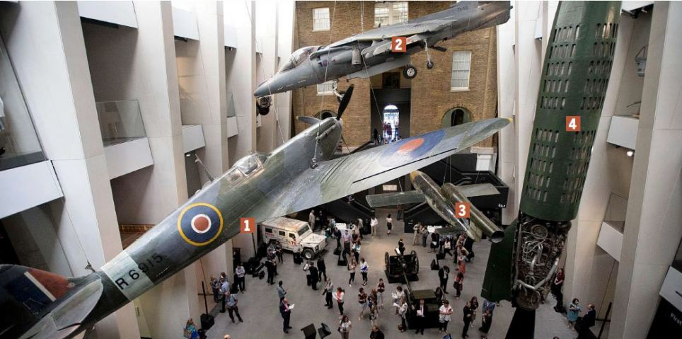 Visitors to the newly refurbished Imperial War Museum are welcomed into the new atrium by the sight of a Spitfire, swooping mid-air alongside a revolutionary harrier jump jet, a V-1 'doodlebug' flying bomb and the V-2 rocket