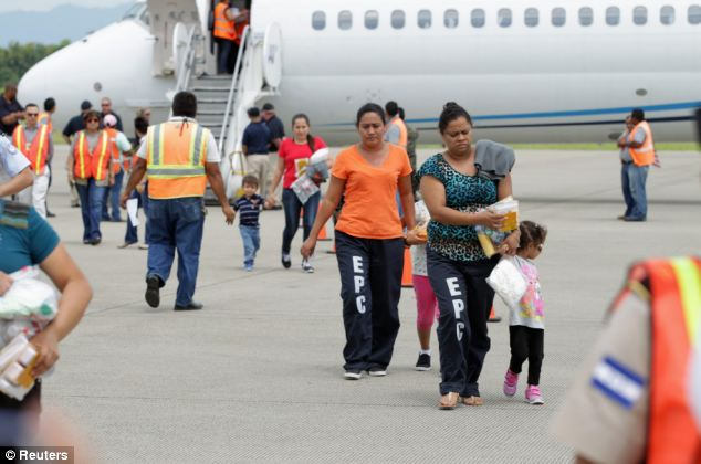 Back they go (in small numbers); Women and their children are being deported back to Honduras (shown) and other countries, but in tiny numbers compared to how many are entering each day
