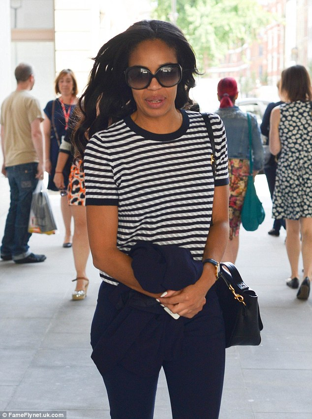 Taking it easy: The Radio DJ wore a stylish striped T-shirt which she teamed with a tailored navy pants as she headed into work