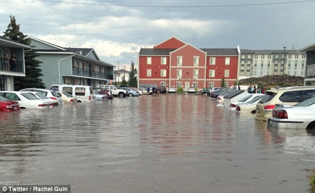 In Rexburg, Idaho, a heavy thunderstorm caused intense flooding with up to waist-deep water - one of several bouts of severe weather to strike the U.S. on Tuesday
