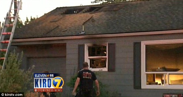 Fire damage: A large hole can be seen in the property's roof after a blaze broke out in the laundry room