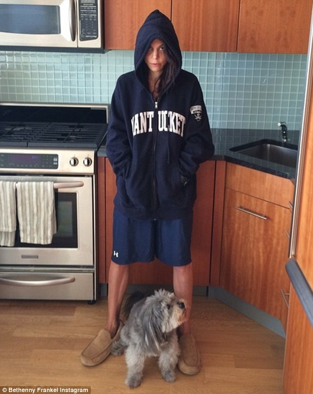 Happy now? Two days after being slammed for setting a bad example as she revealed just how petite she is by slipping into her four-year-old daughter's pyjamas, Bethenny Frankel shared this photo in which she is clad in very baggy men's clothing as she hits back at her detractors