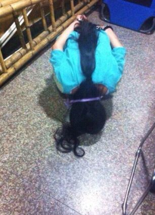 A female thief is humiliated in a shop in China