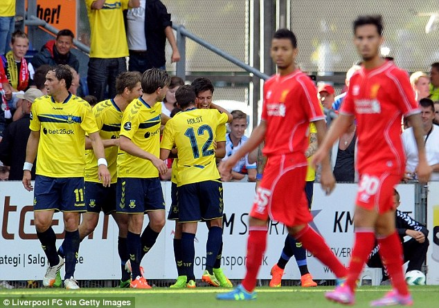 Yellow peril: Brondby players celebrate with Christian Norgaard after the opening goal
